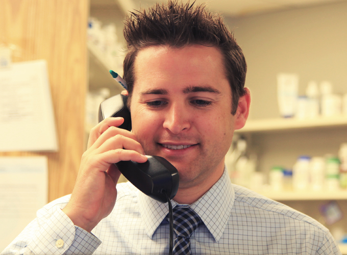 Pharmacist on phone filling emergency out of town prescription