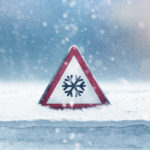 winter safety hazards warning sign in snow